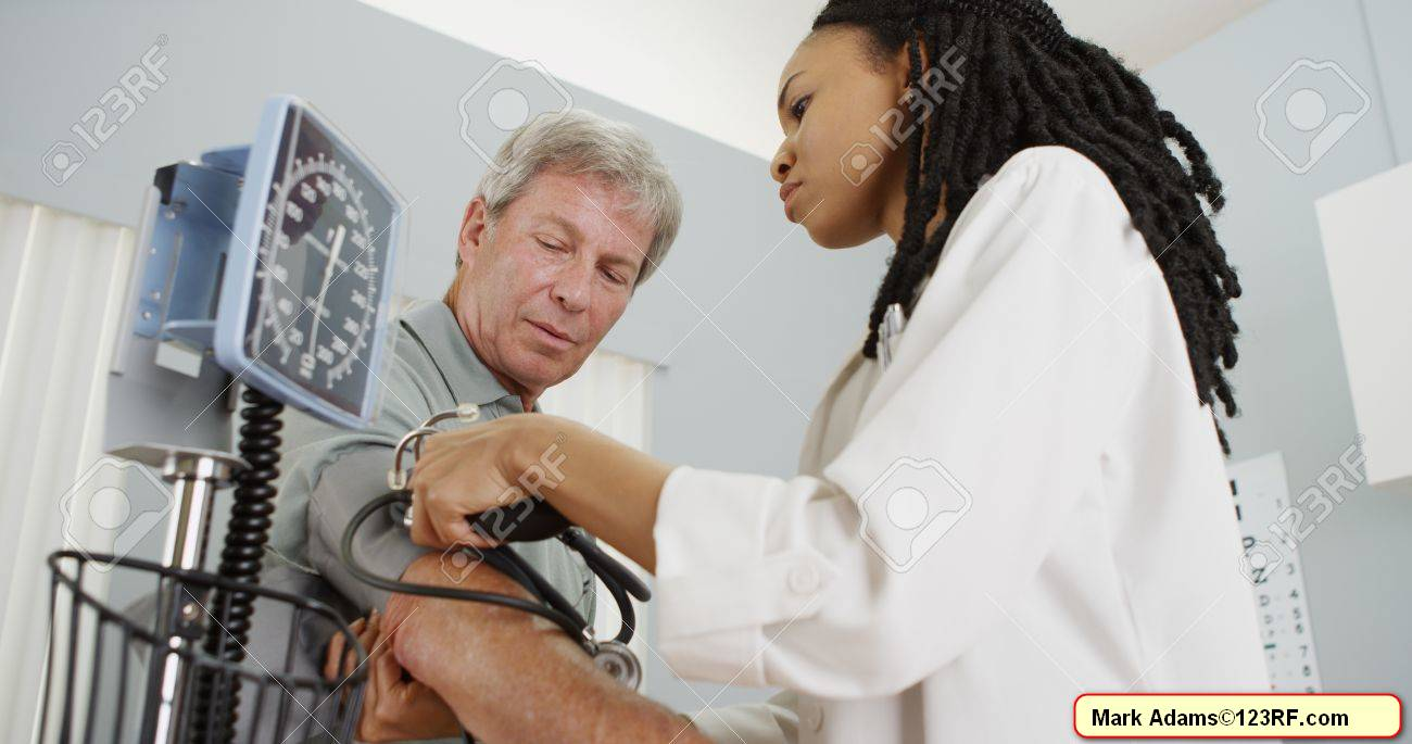 African woman doctor checking patient's blood pressure -Copyright: rocketclips / 123RF Stock Photo