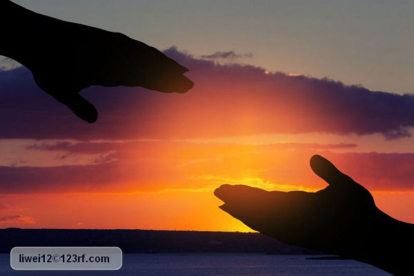 96642224 - silhouette of helping hand on sky background; Copyright: liwei12 / 123RF Stock Photo