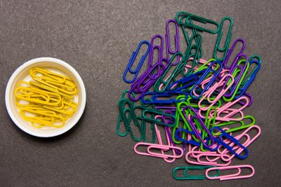 Chaotic disorganized colorful paper clips and to order the yellow paper clip. Image ID : 102908904 Media Type : Photography Copyright : Stanislau Valynkin