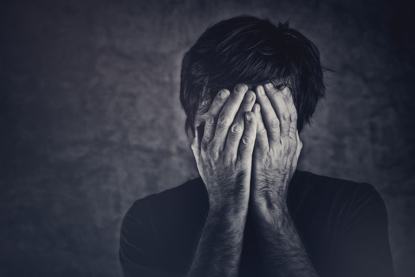 grief, man covering fsce and crying, monochromatic image © Igor Stevanovic/123RF.com