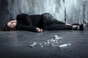 © Dmytro Sidelnikov/ 123RF.com addict lying alone in dark after taking heroin and pills
