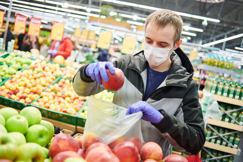 man in mask and protective gloves buying and living a healthy lifestyle