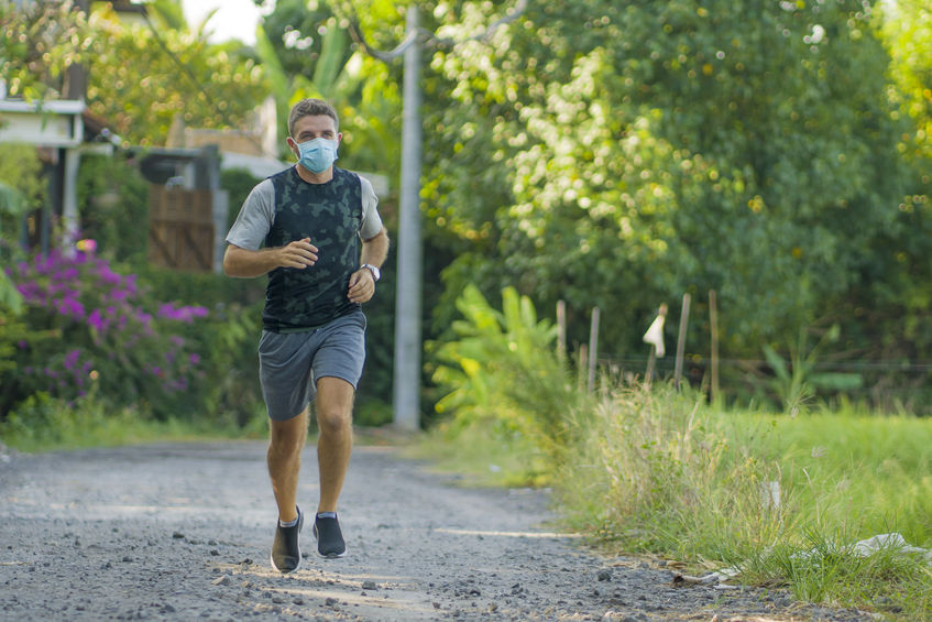 Out jogging with facemask